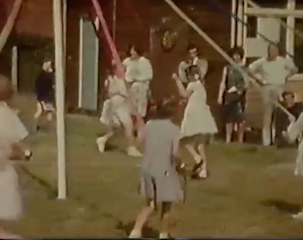 Colour Still from 60s Home Movie with Girls Dancing Round the Maypole