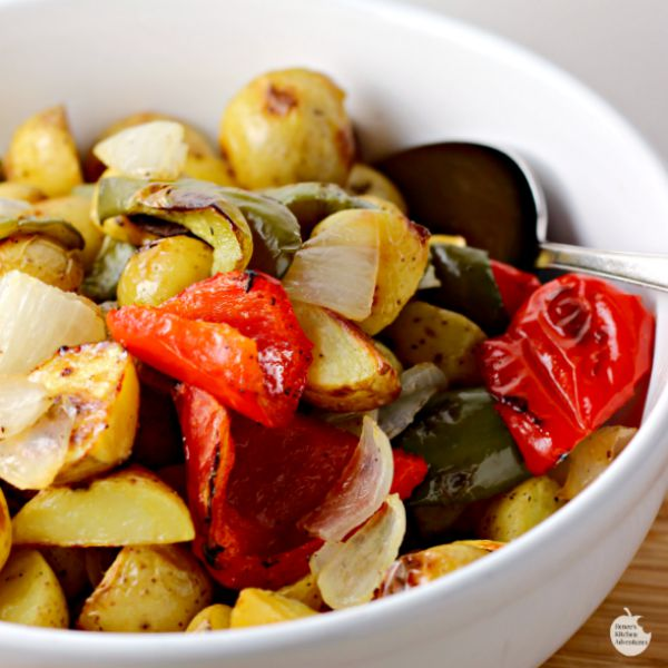 Oven Roasted Potatoes O'Brien | by Renee's Kitchen Adventures - Healthy side dish recipe perfect for breakfast, lunch or dinner!  Potatoes, peppers and onions are perfect partners in this side dish recipe!