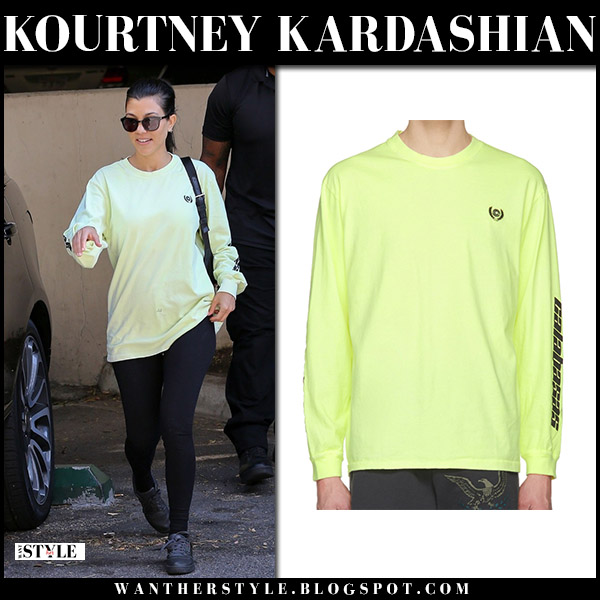 Kourtney Kardashian in yellow green sweatshirt yeezy and leggings street style may 9