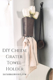 using a cheese grater as a towel holder in the kitchen