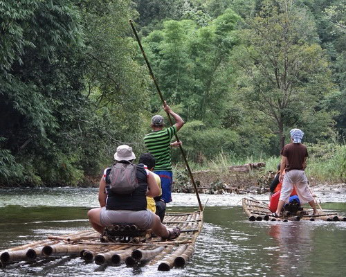 Travel.Tinuku.com Loksado bamboo rafting on Amandit river, a spectacular traditional whitewater adventure in Borneo jungles