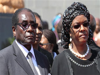 Zimbabwe's ruling party: Mugabe and his wife can stay in the country without trial