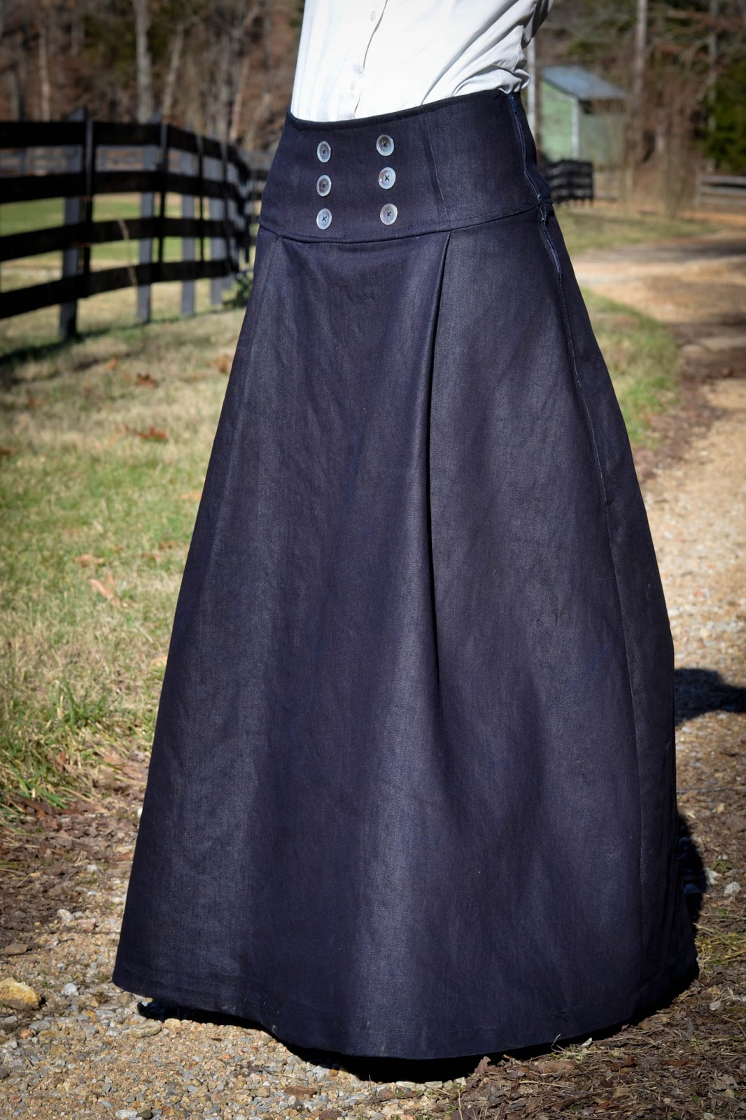ca54e026e This skirt features a high waistband, button detail, and pleated, but  flattering, skirt front.
