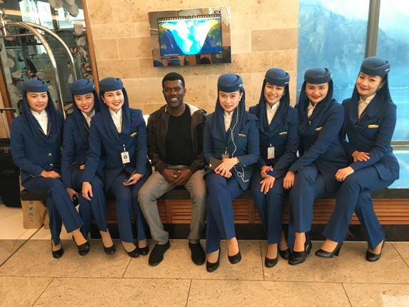 Reno Omokri surrounded by beautiful Air Hostesses at Sofitel Heathrow