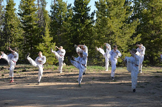 Kids kicking at a martial arts summer camp in the Colorado mountains