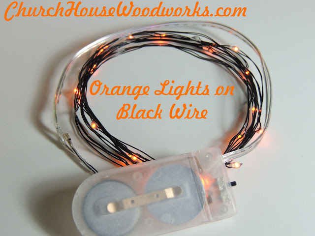 Orange Lights On Black Wire LED Battery Operated String Lights