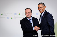 President Barack Obama and French President Francois Hollande greet each other at the Paris climate negotiations Monday. (Credit: COP Paris/flickr)  Click to Enlarge.