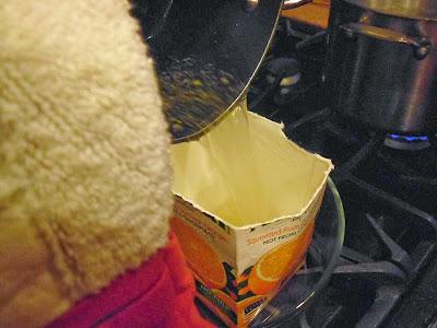 Pouring garlic soap into mold