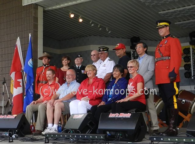 Photographer is taking pictures of the dignitaries involved in the opening ceremonies of Canada Day in Riverside Park
