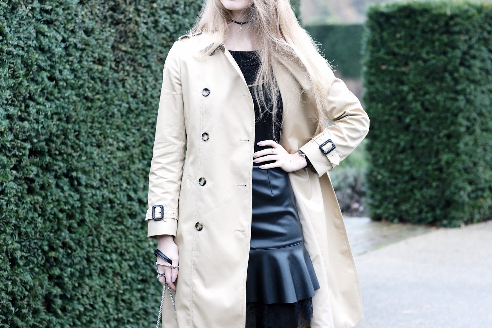 Styling a long beige trench coat for a winter party