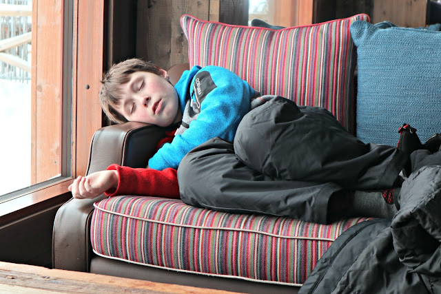 Boy sleeping on sofa