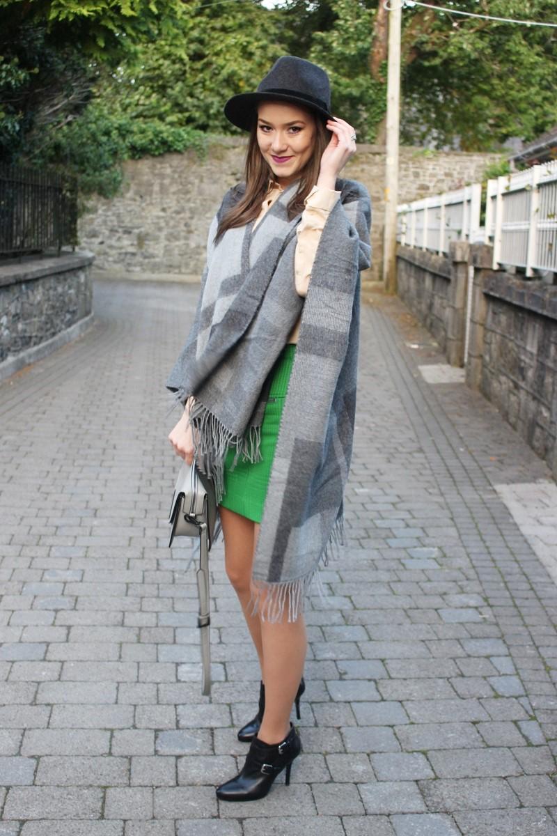 hat, poncho, skirt, heels