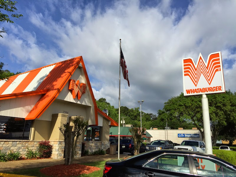 Whataburger in its distinctive A-frame building and Flying W sign