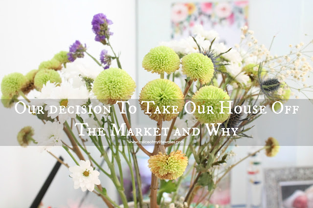 our decision to take our house off the market and why - blog header photo with flowers in background and text over