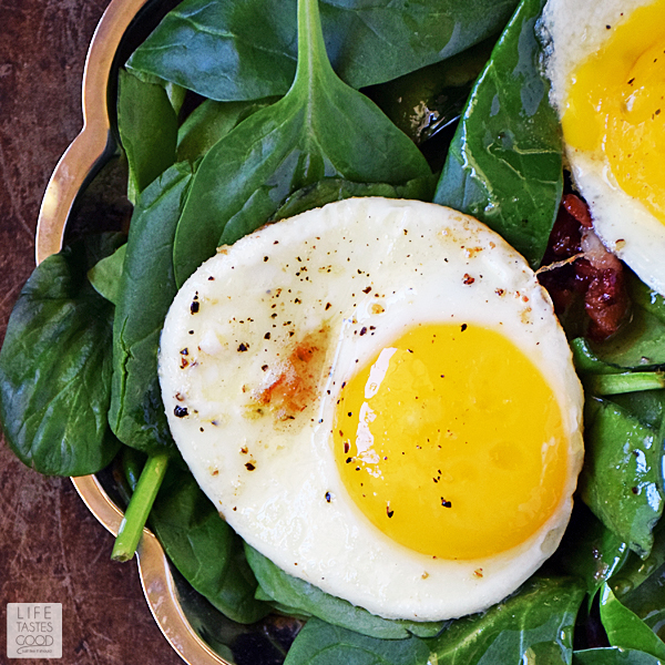 This Low Carb Spinach Breakfast Salad | by Life Tastes Good is a warm comforting way to start the day. Drizzled with Hot Bacon Dressing and topped with a perfectly fried egg, this salad tastes great in addition to being high in protein, and low in carbs. Did I mention it's quick and easy to make too! Winner! #LTGrecipes #SundaySupper