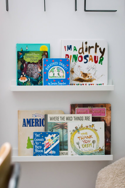 Use book ledges as a space saver in a small playroom