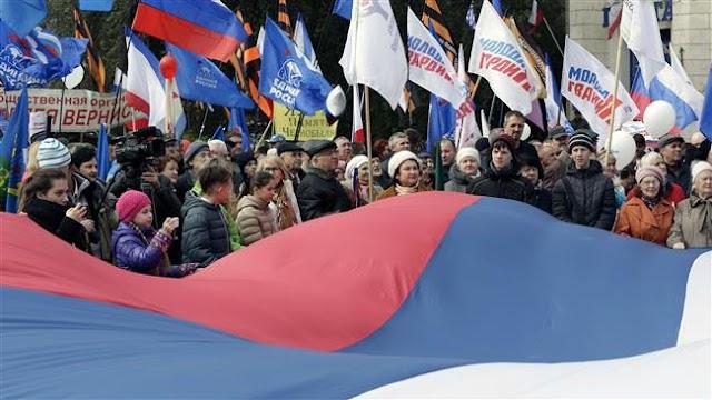 President Vladimir Putin merges Crimea into Russia's southern region