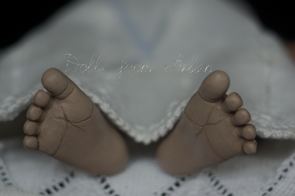 close up of sculpted baby feet (soles)