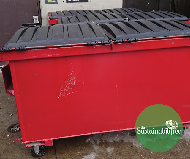 A large red outdoor recycling bin at the University of Ottawa