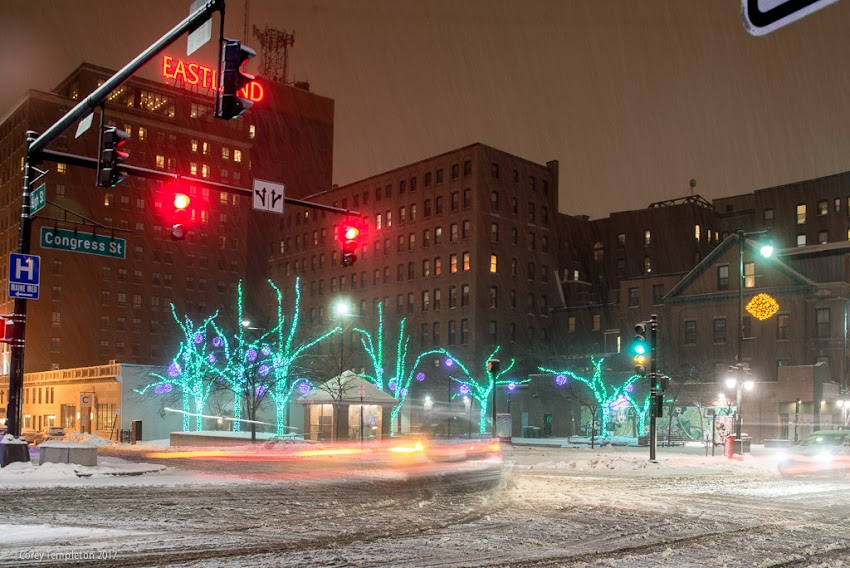 Portland, Maine USA December 2017 photo by Corey Templeton. A light snow falls in Congress Square Park at Congress and High Streets at night.
