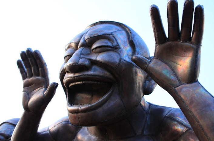 Laughing man statue New York City