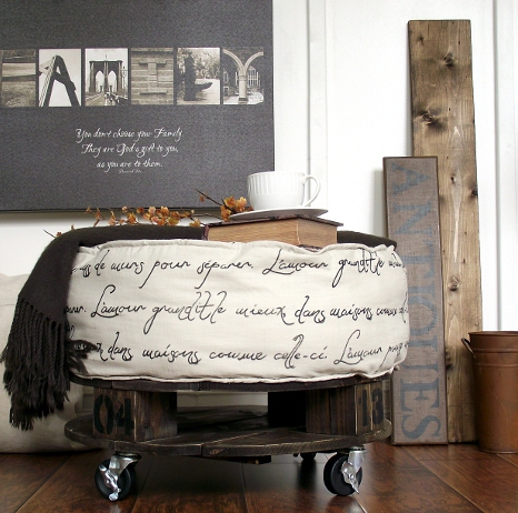This spool shaped ottoman on wheels is a great french-style piece