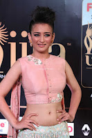 Akshara Haasan in Peachy Crop Top Choli Skirt at IIFA Utsavam Awards 004.JPG
