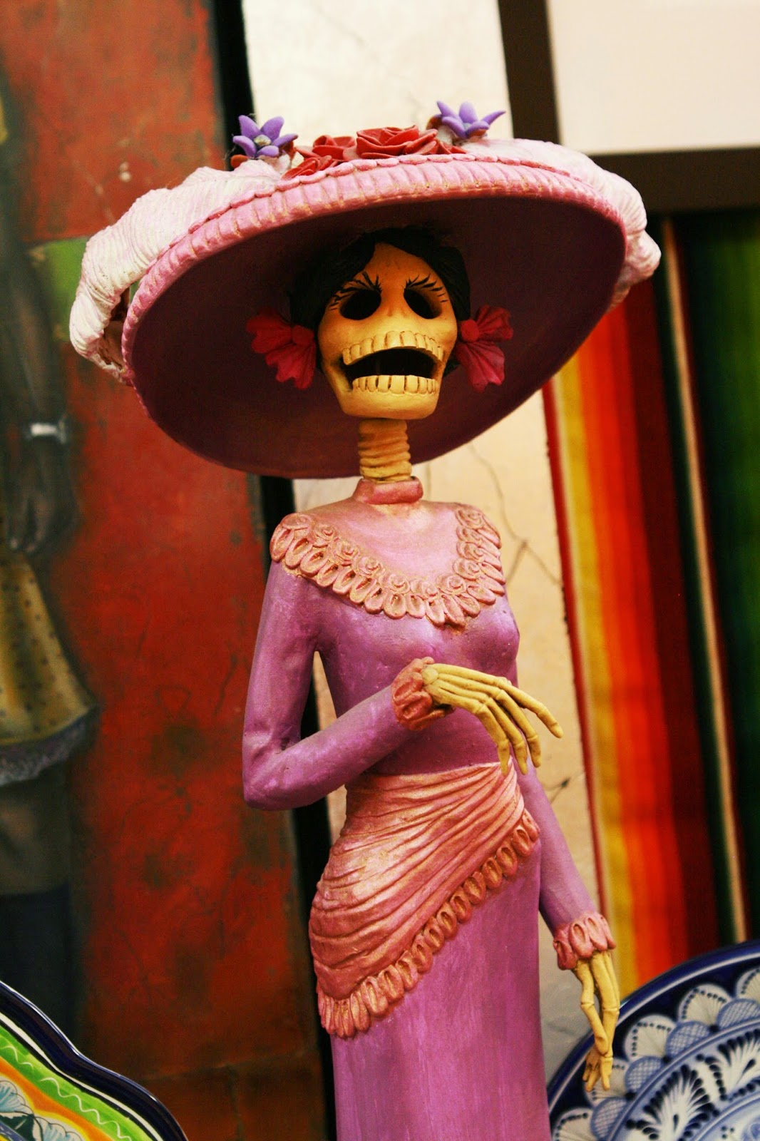 Female skeleton in a hat and dress which looks like its from the Titanic time period.