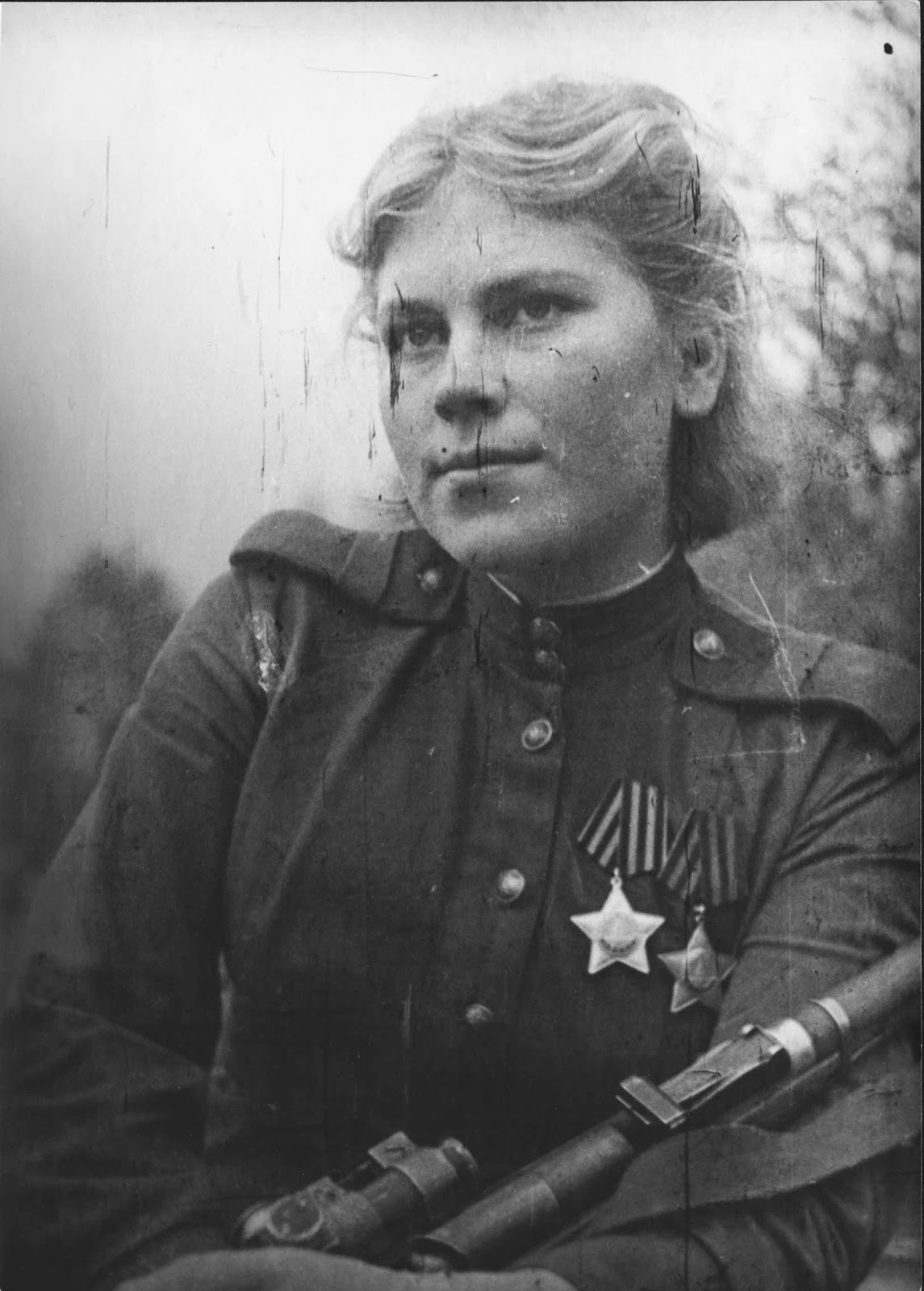 In December 1941, a death notification was received for her 19-year-old brother Mikhail, who had died during the Siege of Leningrad. In response, Shanina went to the military commissariat to ask for permission to serve.