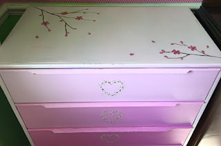 The oriental blossom looks beautiful on this up-cycled set of drawers