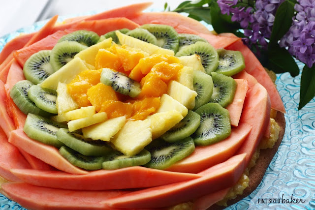Sugar Cookie Crust with fresh papaya, mango, pineapples and kiwi fruit. It's a Tropical Fruit Pizza for the WIN!