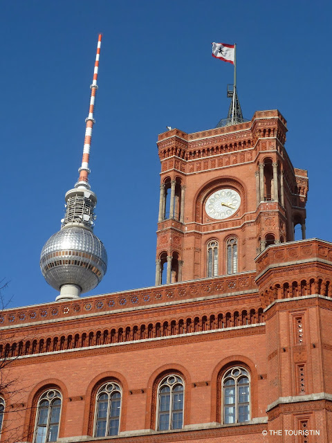 TV Tower and a red brick town hall with the flag sporting a bear.
