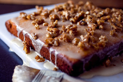 Coat a tender butter cake with a pomegranate glaze and candied walnuts Pomegranate Molasses Butter Cake Recipe