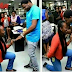 WOW...Nigerian Lady proposes to her man in his office as he is apparently taking too long.