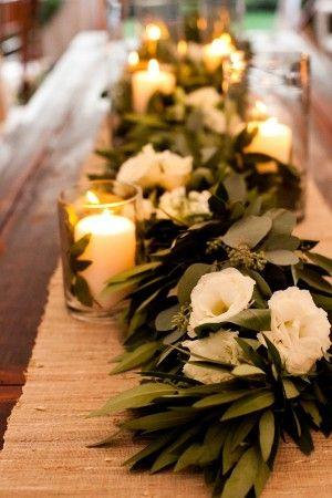 candle lit eucalyptus table garland