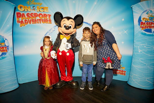 Happy Family meeting Mickey Mouse at Disney on Ice