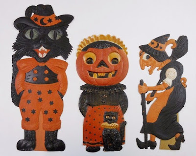 Embossed cardboard, painted orange and black for Halloween.