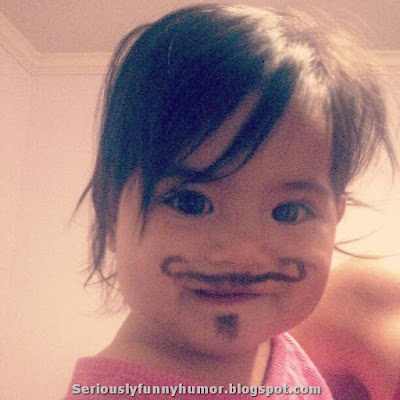 Hilarious girl with drawn mustache!