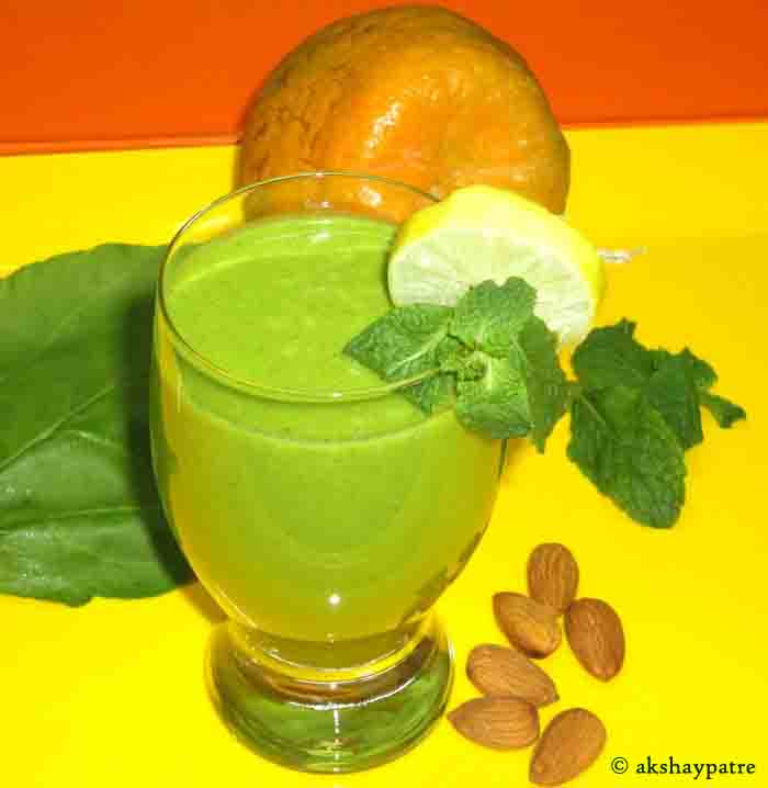 Orange spinach mint almond flax seeds smoothie is ready to serve