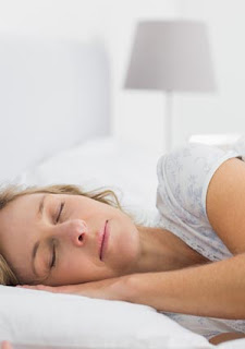 Woman sleeping after using tips to overcome insomnia and get some sleep