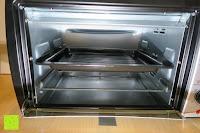 Blech mittig: Andrew James – 23 Liter Mini Ofen und Grill mit 2 Kochplatten in Schwarz – 2900 Watt – 2 Jahre Garantie