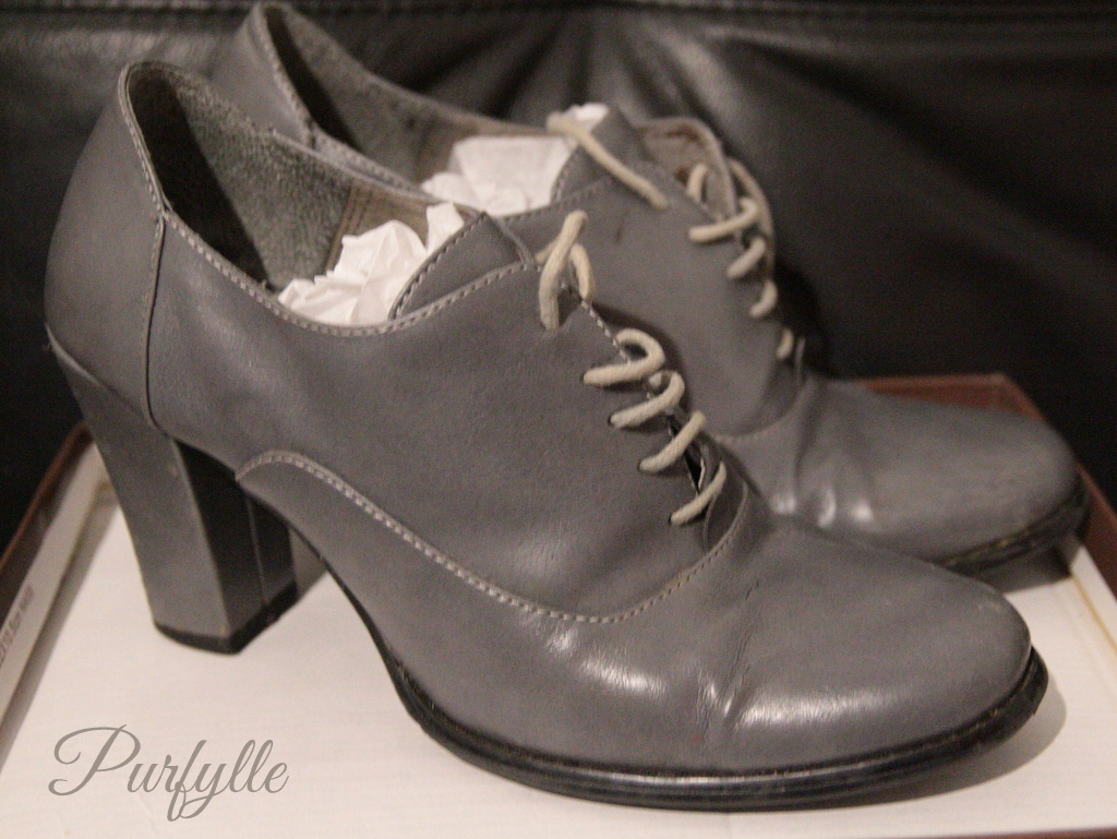 worn to death shoes, grey with high heel and laces