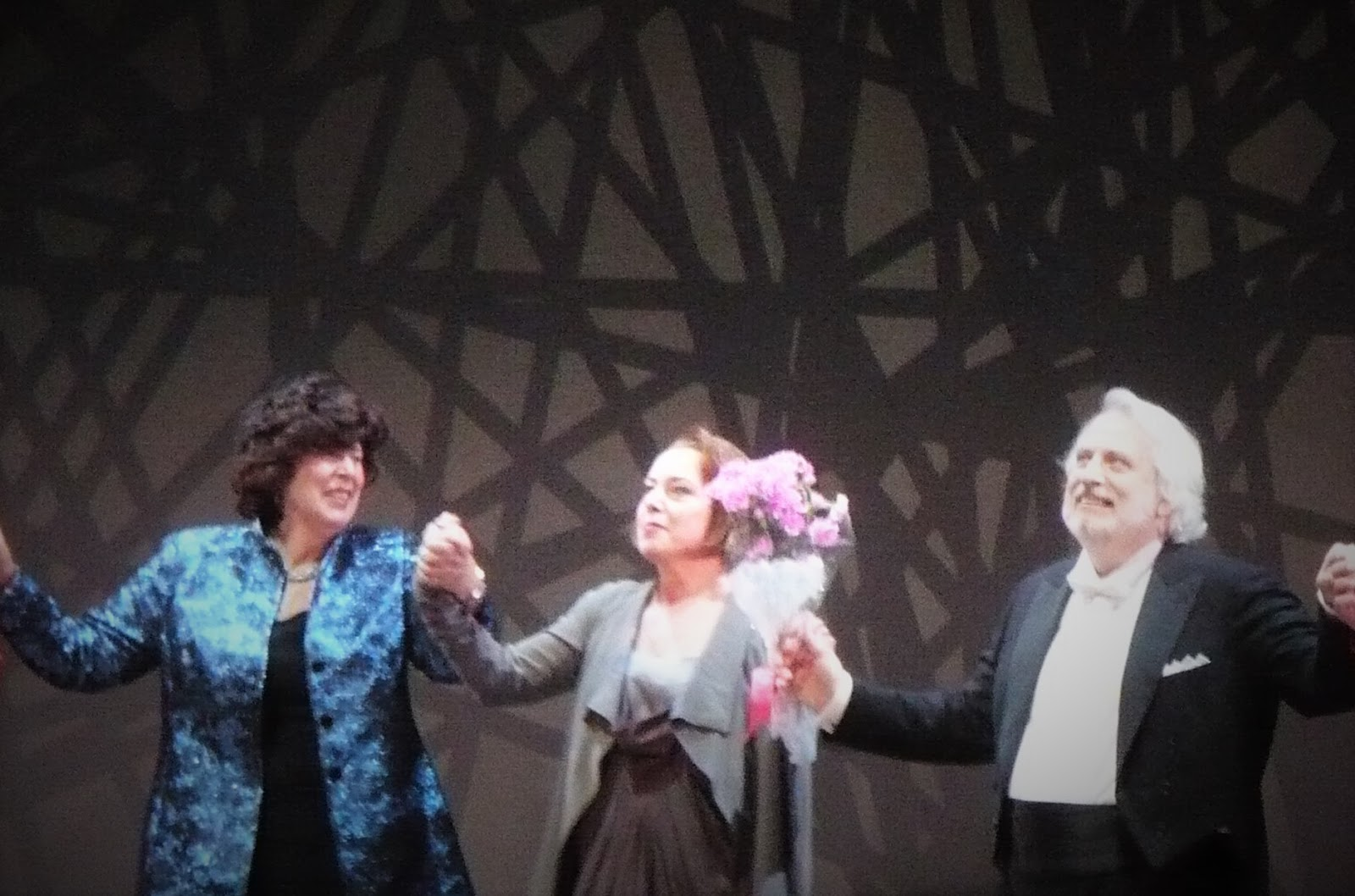 IN PERFORMANCE: (from left to right) Director FRANCESCA ZAMBELLO, soprano NINA STEMME (Brünnhilde), and conductor PHILIPPE AUGUIN duing curtain calls for Washington National Opera's performance of Richard Wagner's GÖTTERDÄMMERUNG, 22 May 2016 [Photo by the author]