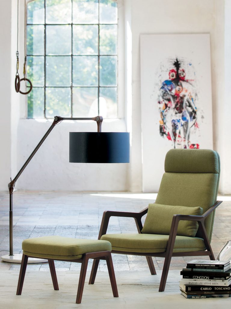 modern green mid century armchair and footstool