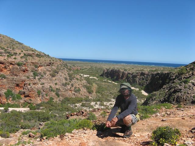 man in hiking gear and head net