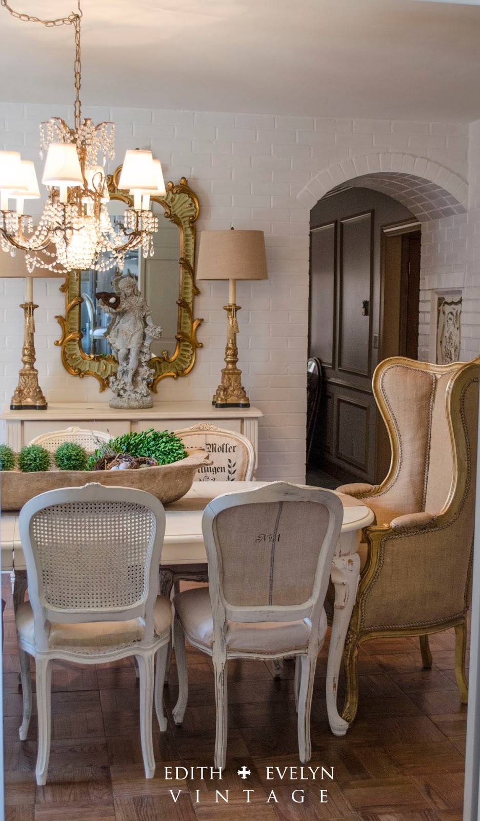 Stunning dininr room decorated in vintage French chateau style.
