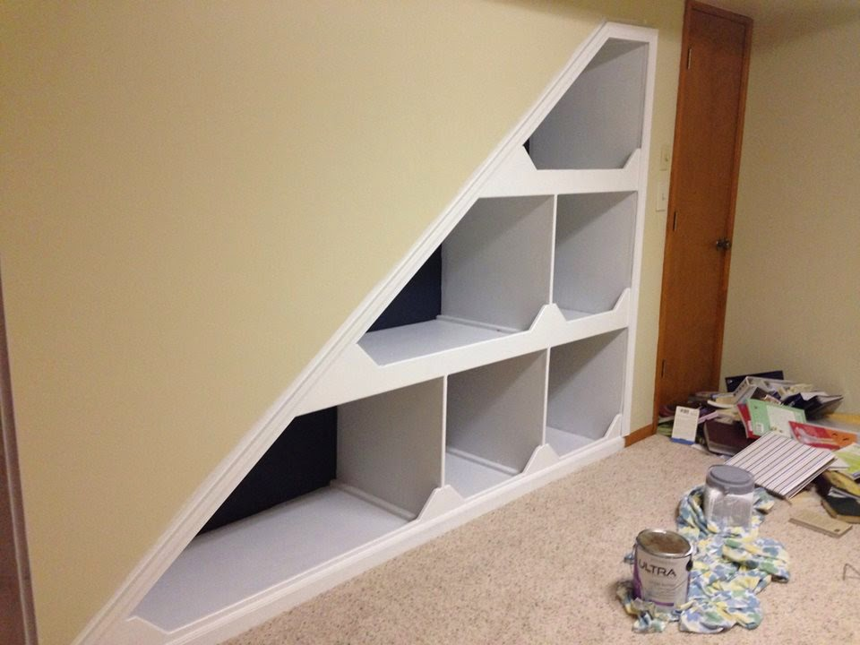 We used Benjamin Moore Hale Navy to paint an accent color within our built-in bookshelf as well as a refinishing color on our thrift store desk. I am in love with this rich, true navy and hope you can see its true color in this post.