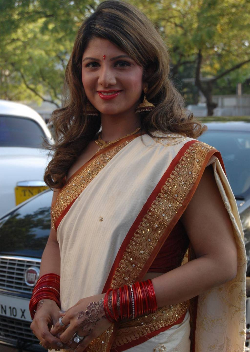 Telugu Actress Rambha Long Hair Stills In White Saree