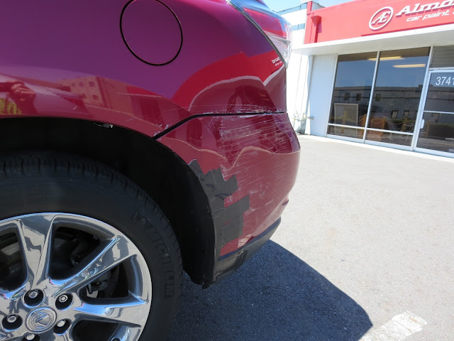 Dent & scrapes on bumper and quarter panel before auto body repairs.
