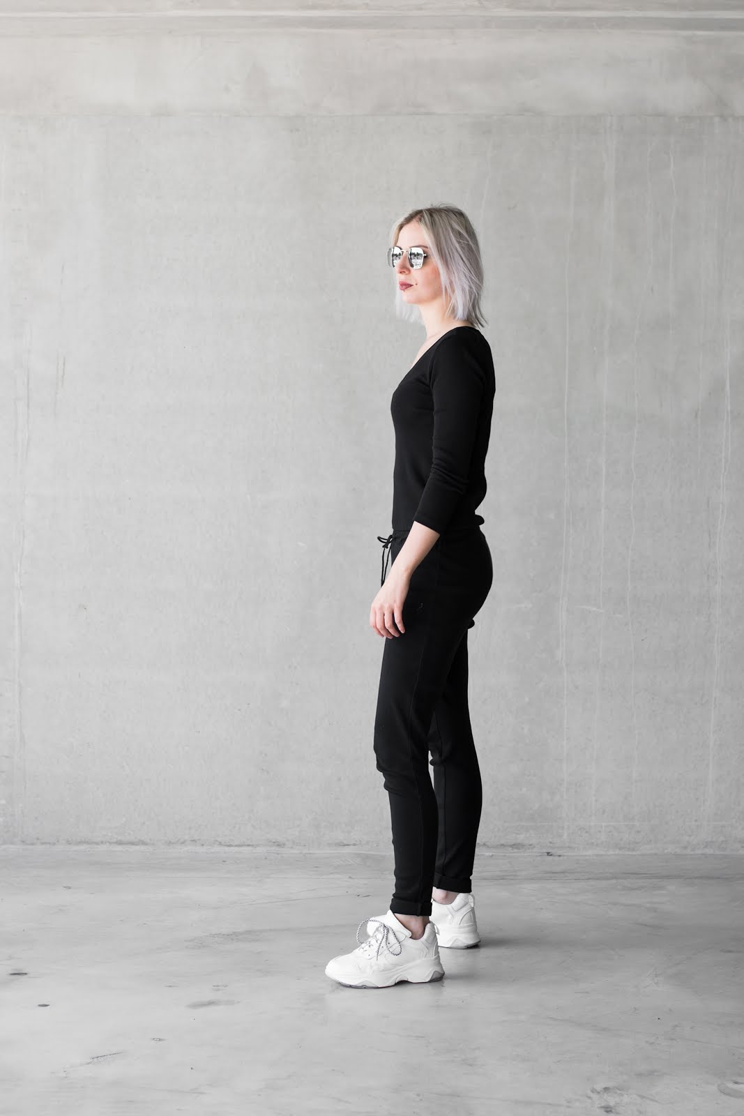 Black jumpsuite, dad sneakers, all white, balenciaga, knock off, sacha shoes, black and white, minimal, street style, sunglasses pull & bear